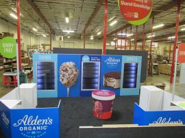 Custom Island Exhibit with Freezers, Sitting Area, Reception Counters, Locking Storage, and Large Format Graphics